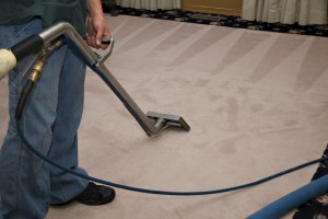 man performing commercial carpet cleaning
