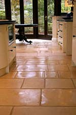 clean natural stone floors in kitchen